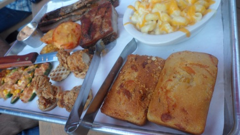 Plate of bbq, snacks, and fixins at at BarQ B.B.Q.
