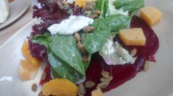 Young lettuce, chevre, pumpkin seeds and an orange vinaigrette