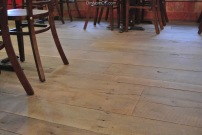 Wide planked floors also show rustic charm at Little Pub Greenwich