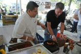 Chef Baez prepares octopus from The Spread with plating help from one of the owners, Chris