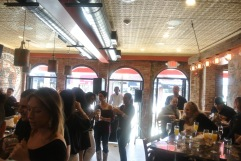 The bumping and busy bar room at Amore Cucina & Bar in Stamford