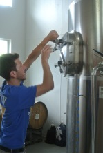 Barry showing off the tanks where the magic happens at Kent Falls Brewing