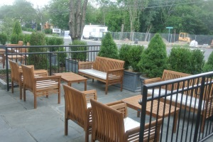 The outdoor waiting area at Lugano Wine Bar & Salumeria in Old Greenwich CT