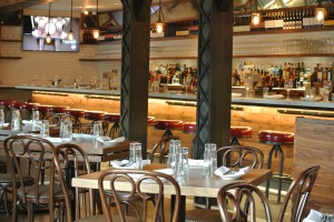 Tables spill out into the bar area at Lugano Wine Bar & Salumeria in Old Greenwich CT