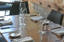 Tables in the main dining area at Mill Street Bar & Table