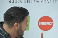 Adam Richman looking at OmNomCT logo LOL