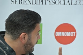 Adam Richman looking at OmNomCT logo LOL