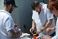 Chef Petroni, Chef Falco, and crew plate the corn dogs at Pizza Surf Club @ Fortina Stamford